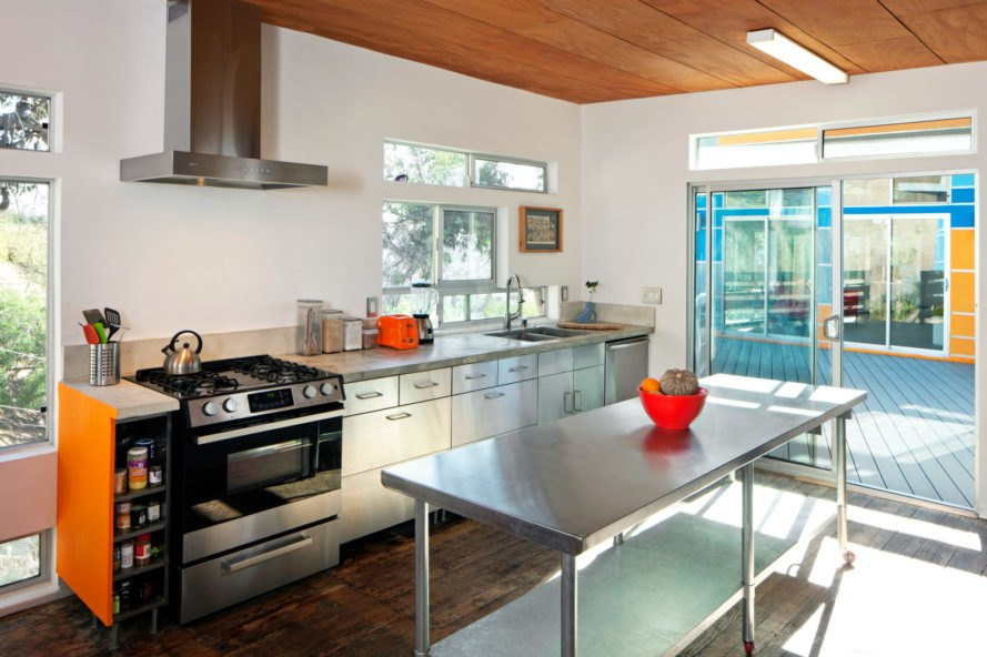 white kitchen with steel cabinets and energy-efficient appliances
