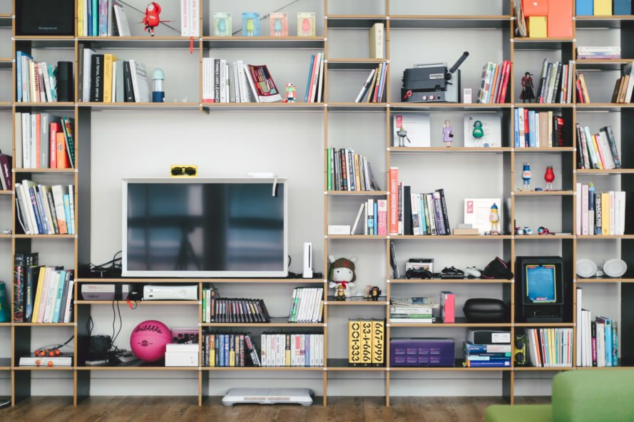full-height bookshelf with large open space where a flat-screen TV sits