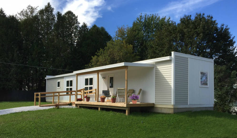 Vermod designed zero-net-energy homes after Hurricane Irene for to replace mobile homes destroyed by flooding. Credit: Vermod Homes