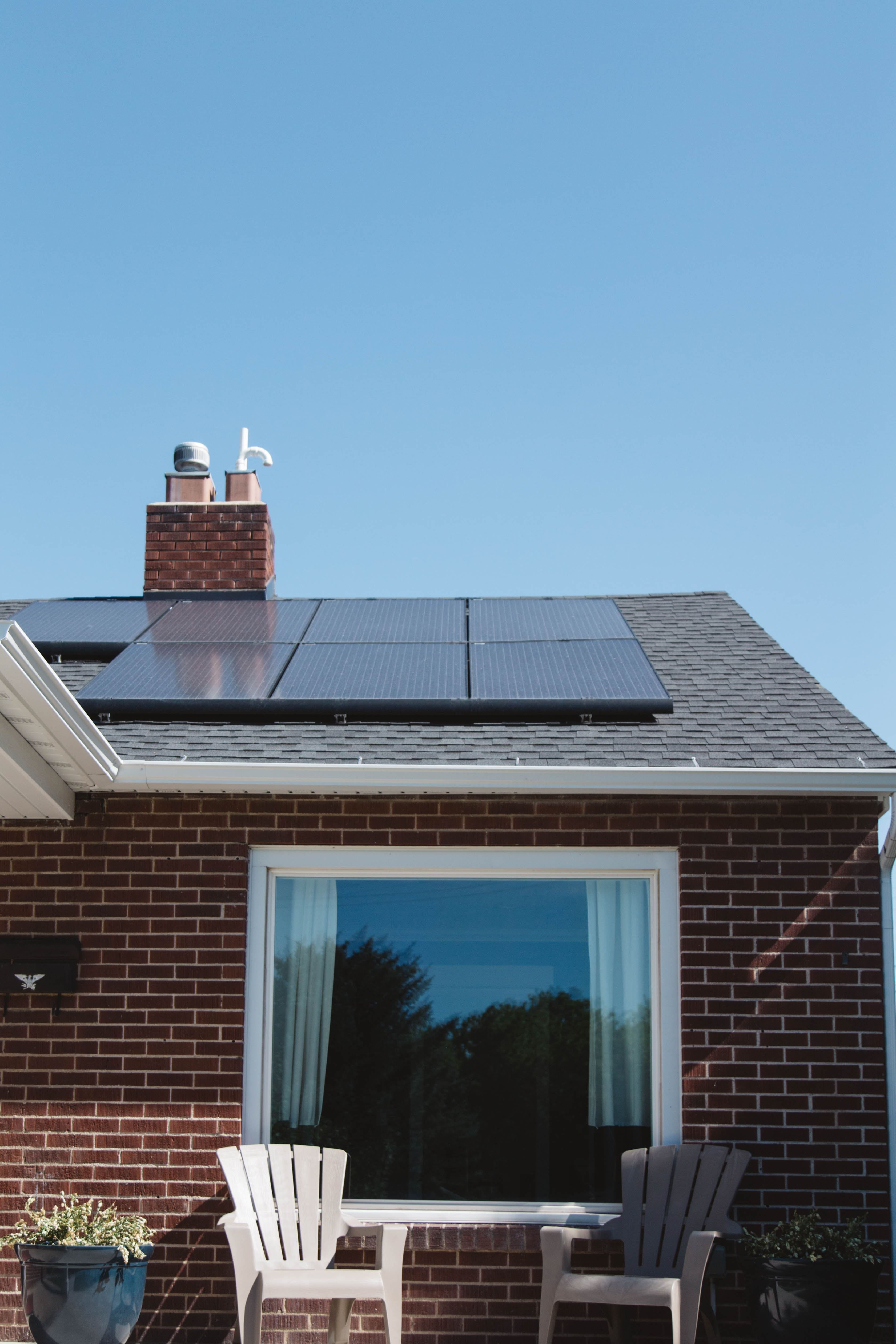 A house with solar panels mounted on its roof